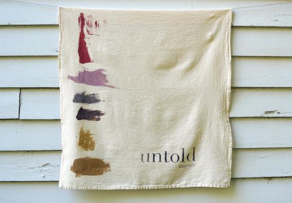 untold imprints tea towel