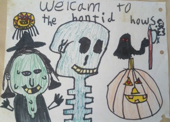 child's haunted house sign