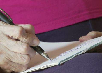 womans hand writing letter